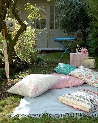 this brings an idea to mind.  make outdoor pillows with treated fabric to lay in the grass.