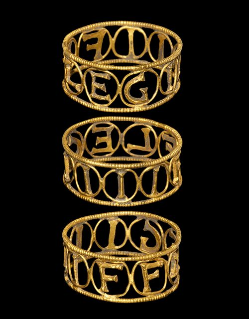 "Roman Gold 4th Legion Flavia Felix Ring, 1st-2nd Century AD A broad openwork gold hoop with beaded wire borders, filigree loops enclosing cast D-section letters 'LEGIIIIFF' for Legio IIII Flavia Felix. The Legio Quarta Flavia Felix (""Lucky Fourth Legion of Flavia""), was a unit of the Imperial Roman army, founded in 70 AD by Vespasian (r. 69-79) from the remnants of the Legio IV Macedonica disbanded after the Batavian revolt. The legion was active in Moesia Superior until the early 5th CE"