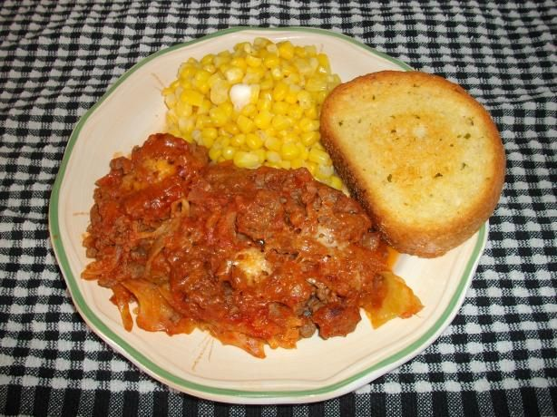 Ground Beef and Cabbage Casserole from Food.com: A simple casserole to put together. The main ingredients are: ground beef, shredded cabbage, onion, garlic, tomato sauce, crushed red pepper flakes, salt & pepper, plus grated parmesan cheese. (You can substitute seasoned ground pork sausage for the ground beef, and traditional-style spaghetti sauce for the tomato sauce.)