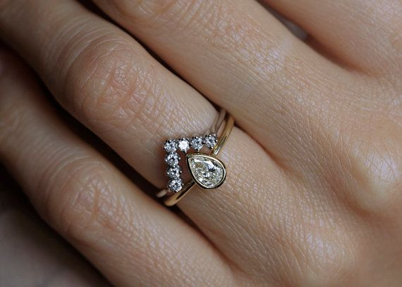 Handmade wedding set of sparkly 0.5 carat pear-shaped Diamond ring and a stacking V shaped Diamond band.  Product details Pear Ring Gemstone: Diamond