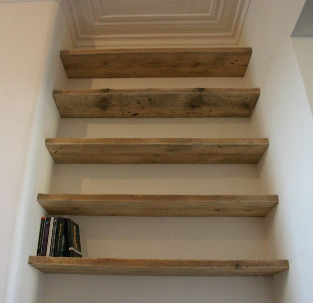 Reclaimed scaffolding boards used for alcove shelving.. Great for the closets :)
