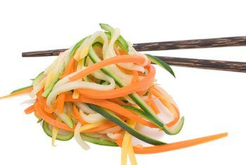 Carrot and summer squash spaghetti with chopsticks image by Jack Kunnen from Fotolia.com