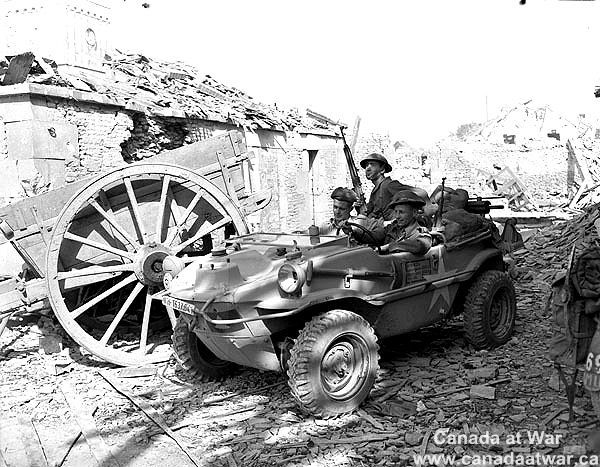 Personnel of the South Saskatchewan Regiment in captured German 'Schwimmwagen' amphibious car of the Wehrmacht. Rocquancourt, august 11, 1944.