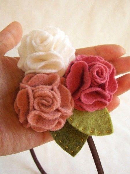 Cute felt geraniums... gotta figure out how she made these...