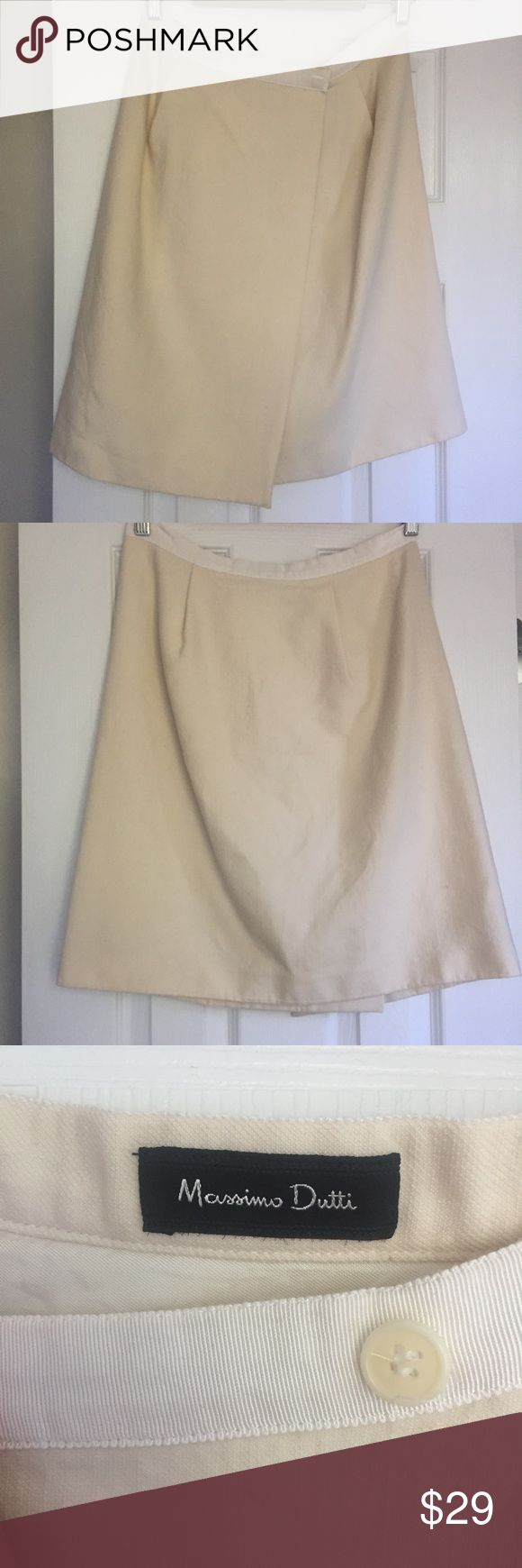 Massimo Dutti Wrap Skirt Beautiful gently worn Massimo Dutti light weight wool wrap skirt. Size 42/ US 6. A small stain on the inside which does not show on the outside of the skirt and a small barely noticeable hole in the back (see photos). Massimo Dutti Skirts Mini