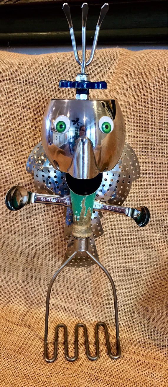 When I found this vintage potato masher, I saw this cute guy in my minds eye. His head is a stainless creamer, his mouth is a stainless measuring spoon, his head feathers are a vintage faucet handle & a mini rake. His body feathers are stainless steamer leaves & his arms are stainless measuring spoons. I decided to give him green eyes to match his green body. I kind of like how all these pieces came together! He stands, 14 tall.