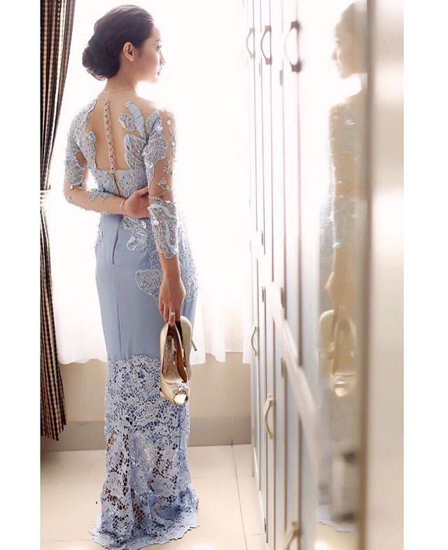 Loving this beautiful shot by @rezaaditya_photo for @ansafrina Engagement day Gown by #dinavahada Fabrics by @bindusamtani_pim1