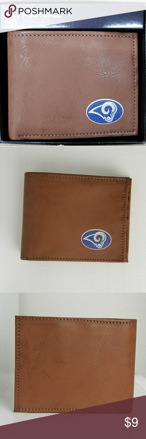 Los Angeles Rams Classic Wallet Officially Licensed NFL Los Angeles Rams Classic Football Wallet. This folding wallet features a team color Los Angeles Rams team logo, six card slots and one pocket on each side behind the card slots. The box has a crinkle on the top lid as shown in the last picture. NIP. NO TRADES. PRICE FIRM. NFL Gamewear Bags Wallets