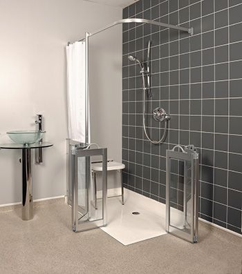 wf12 left handed half height twin bifold shower doors in silver with glass