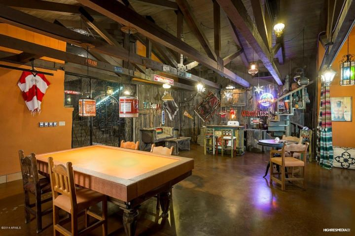 Eclectic Bar with Concrete floors, Exposed beam, Pendant light, High ceiling