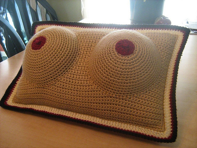 Boobie Pillow Pattern by Martha Clem - This pattern is available for free. For more information, see: http://web.archive.org/web/20020209003740/home.inreach.com/marthac/crochet6.html