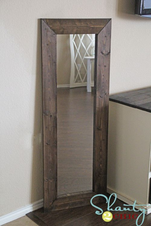 Thrifty tutorial for taking a cheap walmart mirror and giving it a wide wood frame.