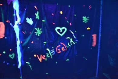 Decor kazebo with black bags and neon and glow in the dark paint