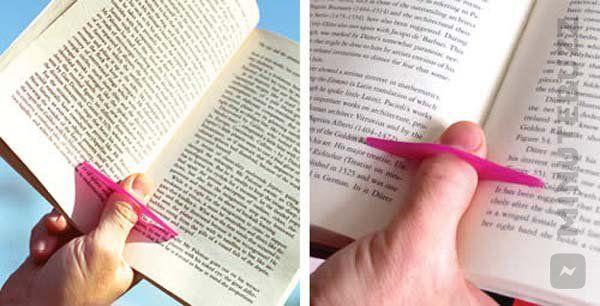La bague de pouce pour faciliter la lecture