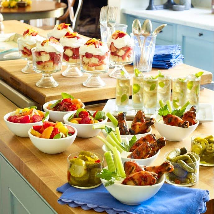 Food: Food Station With Small Bowls Of Wings With Celery