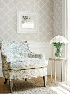 Neutral wallpaper paired with a matching, mixed print