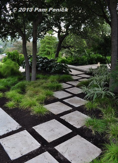 Half the lawn is gone in this elegant, contemporary garden by Sitio Design. I love the diagonal pavers leading through Berkeley sedge and variegated dianella groundcovers. Click through for more pics. | Digging