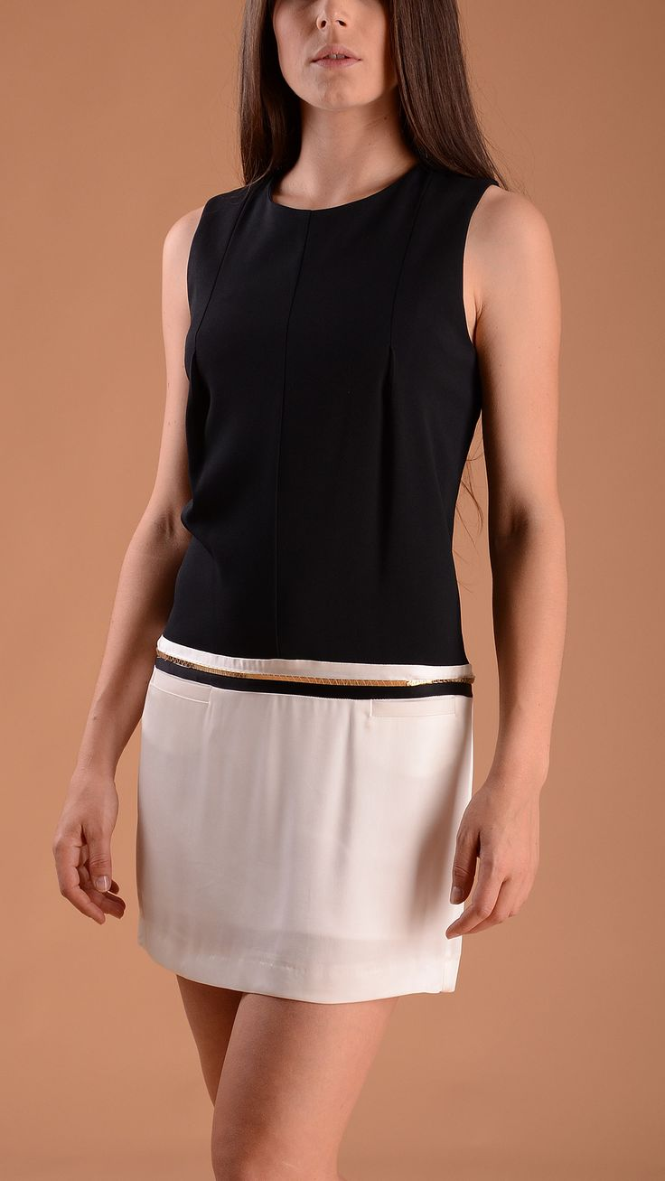 Atos Lombardini Sleeveless black and white dress, golden metal detail at waist