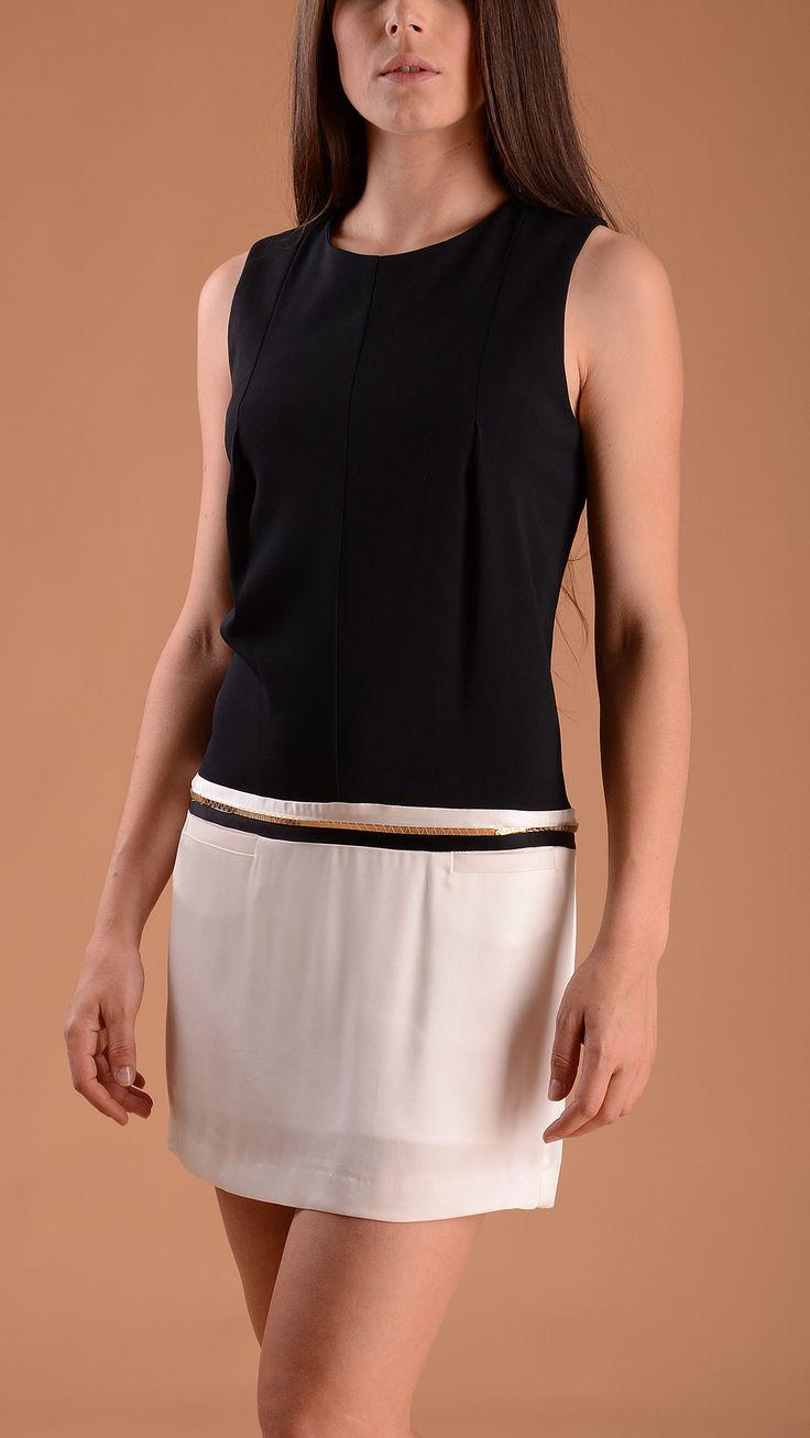 Atos Lombardini Sleeveless black and white dress, golden metal detail at waist