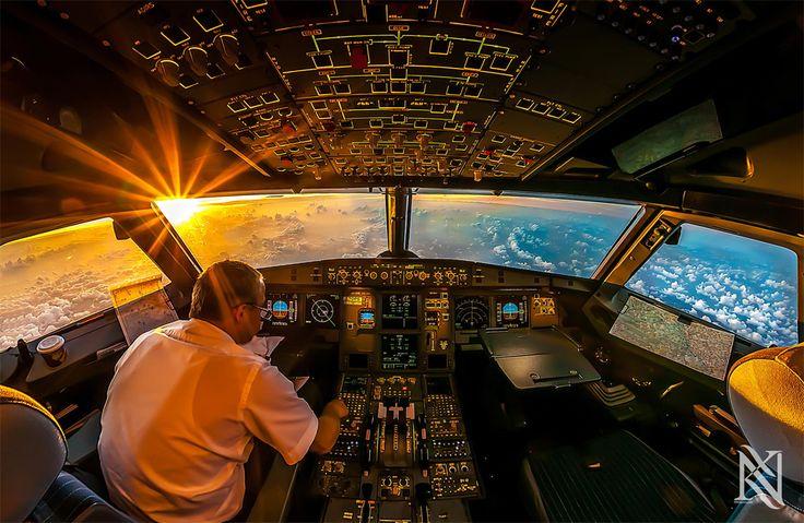 sunrise in airplane cockpit