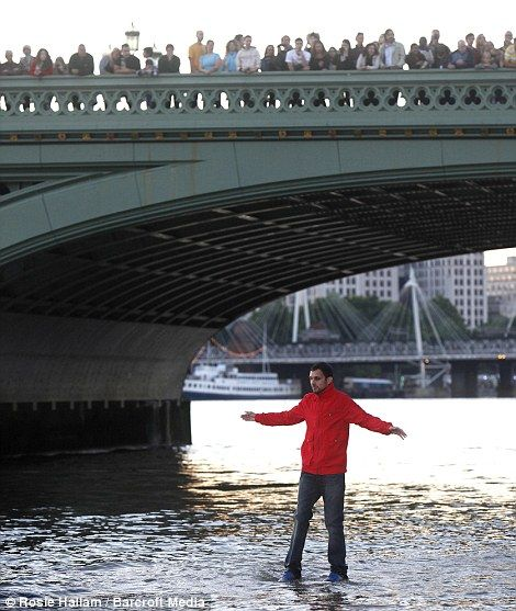 stunned onlookers watch from Westminster Bridge as Dynamo gets his feet wet