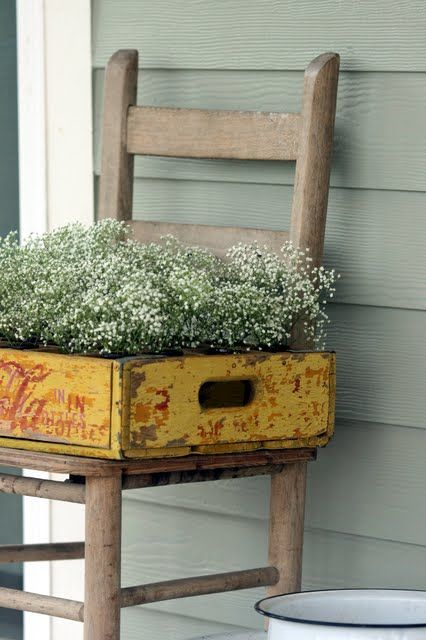 Old wooden chair and distressed box become a sweet #porch #planter at Cedar Hill Farmhouse.