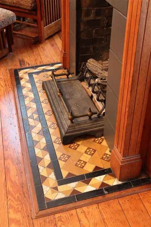 I like the tile work here with the wood floor