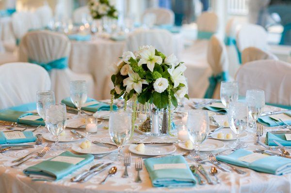 Tiffany blue was the color of choice for this wedding.  Lush white floral arrangements with hints of green decorated the tables.: Table Decorations, Blue Napkins, Tiffany Blue Weddings, Wedding Ideas, Table Setting, Blue Table, Blue Wedding Centerpieces
