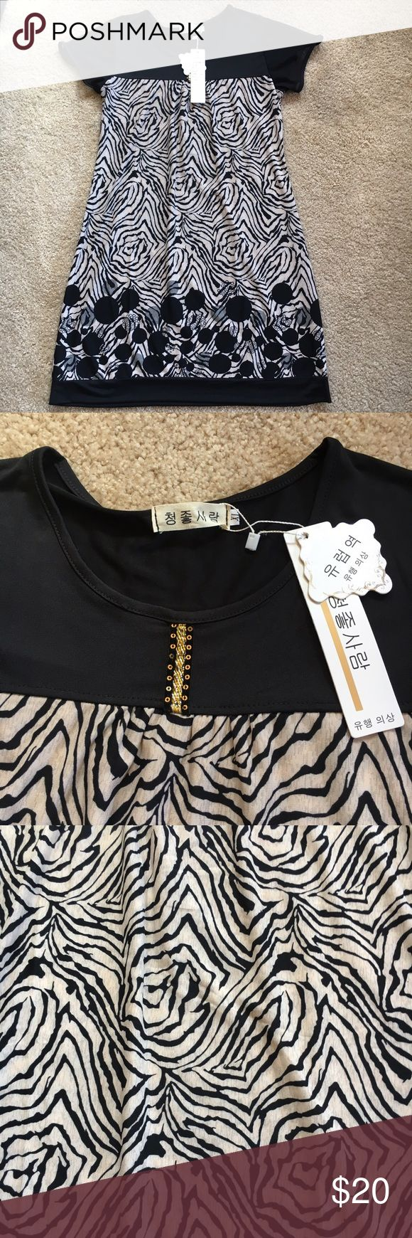 Dress, Zebra Print Black/Beige Summer Brand new with tags, I don't know what it says. It was a gift but its not me, never tried it on. Cute detail in front, great as a beach cover up or any other summer activity. It's light, so I'm sure it won't get you too hot. Sleeves are sheer and has that edgy animal print! Hurry before it's gone, everything must go! Bundle and save on shipping! Says XL most likely in juniors sizing and I'd say it's more M/L but really could fit a small too if you like…