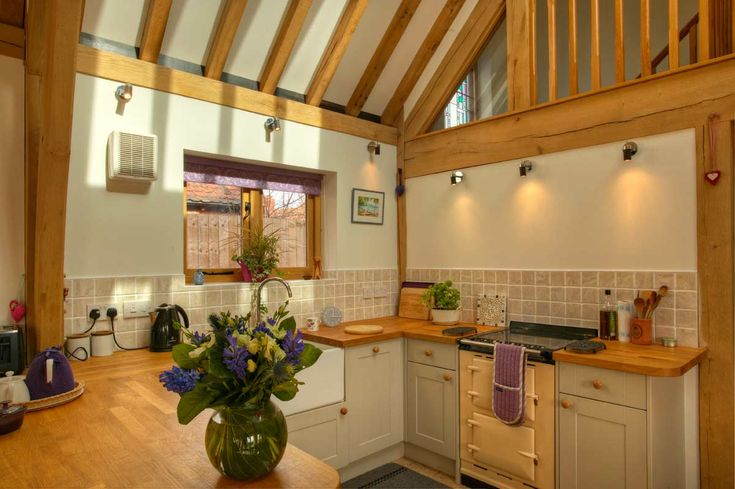 Open-plan kitchen area from Welsh Oak Frame. #oakframe #kitchenideas