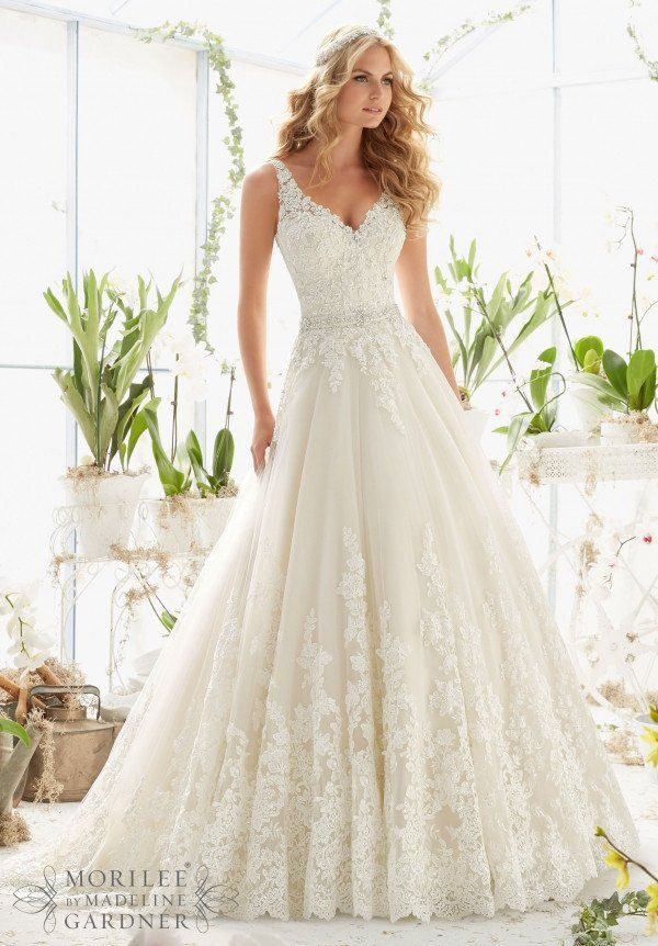 """CLASSIC TULLE BALL GOWN WITH CRYSTAL BEADED, ALENCON LACE APPLIQUES AND WIDE SCALLOPED HEMLINERemovable Beaded Satin Belt. Beaded Satin Belt Also Sold Separately as style #11224. Available in Three Lengths: 55"""", 58"""", 61"""". Colors available: White, Ivory, Ivory/Light Gold"""
