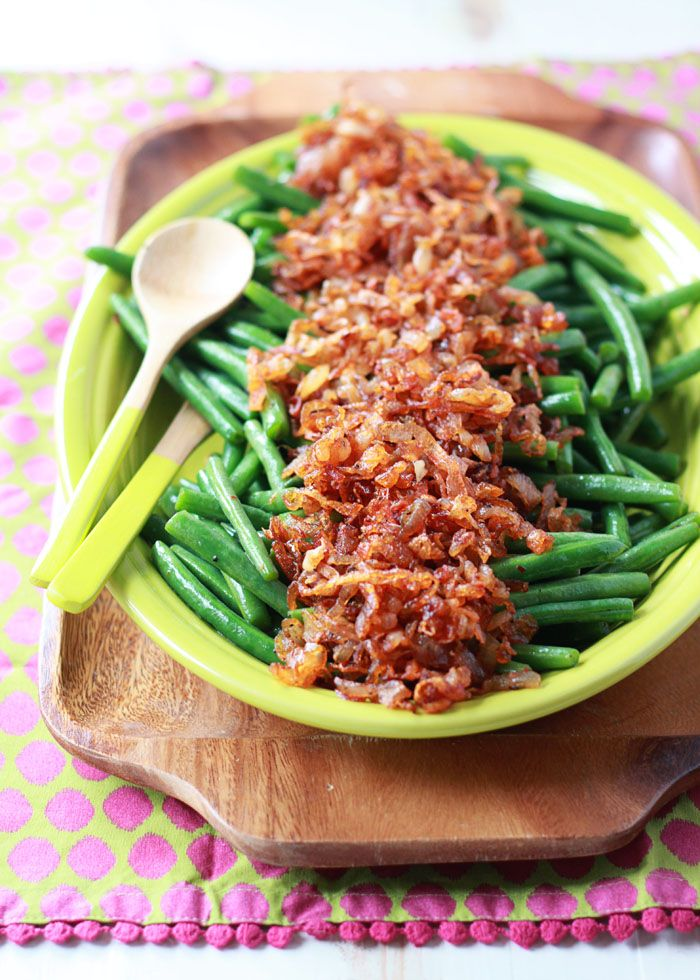 Sauteed Green Beans with Smoky Shallots - Tender green beans topped with smoky sauteed shallots instead of bacon. This vegetarian (and vegan!) side is a welcome addition to the holiday table.