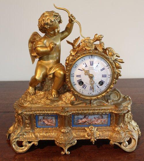 Antique A French Porcelain and Ormolu Mantel Clock