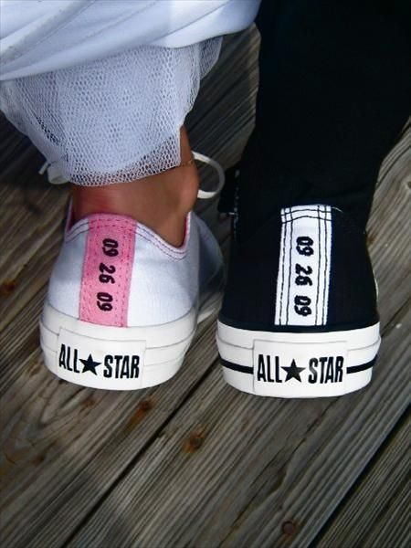 Bride and groom with converse that has the date embroidered on the back! Pretty Sure EVERYONE should wear CONVERSE.  ALL bridesmaids should wear the same color that would match all our dresses.  Along with flower girl, ring bearer, etc...  You know Kenny talked about it!  ;p   (bright pink)