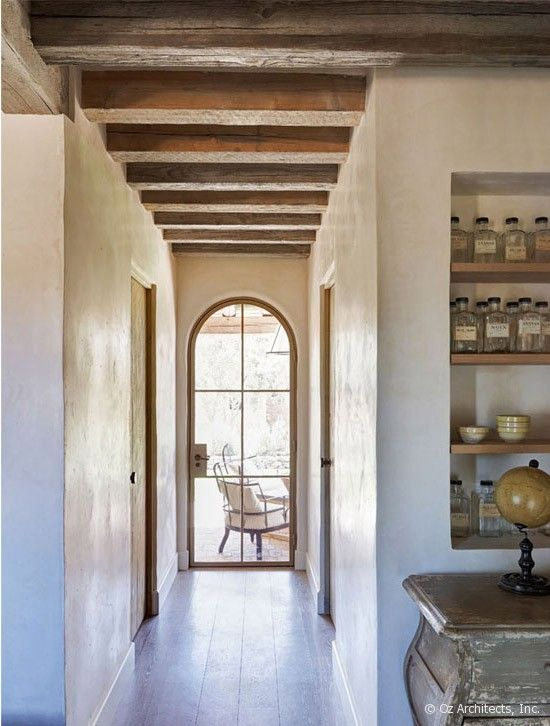beautiful hallway with arched window  I like the exposed beams too.