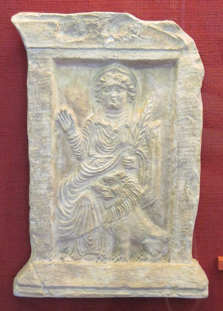 Allāt with a palm branch and lion from the Ba'alshamîn temple in Palmyra, first century AD.