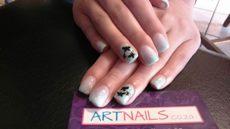 Light blue glitter ombre acrylic nails with butterfly hand drawn nail art