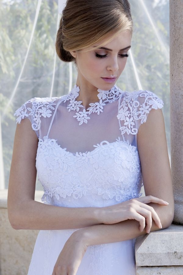 White A-Line gown with embroider Chantilly and guipure lace combined with a removable lace cardigan and overskirt