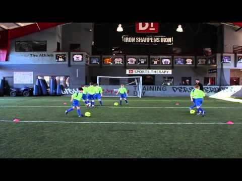 Soccer Drills - The Dribble Across Square soccer drill is a game and is the best way to teach players U8 and older to dribble. They learn twice as fast. NO LINES. Every player has a ball. http://www.SoccerHelp.com/soccer-videos/best-soccer-dribbling-drill.shtml
