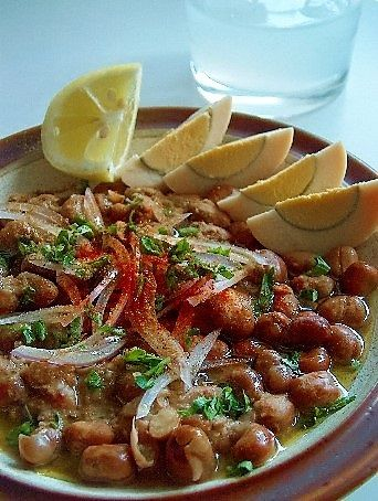 Wiki: African Cuisine: Ful Medames, one of Egypt's national dishes, with sliced eggs & vegetables. - Wikipedia