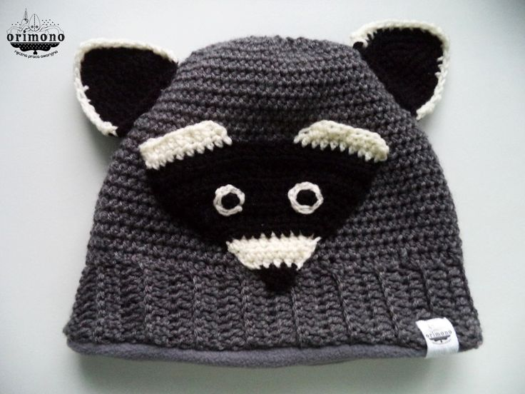 Raccoon madness! Warm, crochet cap :)  When pinning, please add my facebook page adress. :)  Like me and get it here! :) http://facebook.com/orimono.reczna.praca.awaryjna