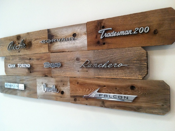 Handmade reclaimed wood art adorned with vintage auto emblems.. $229.00, via Etsy.