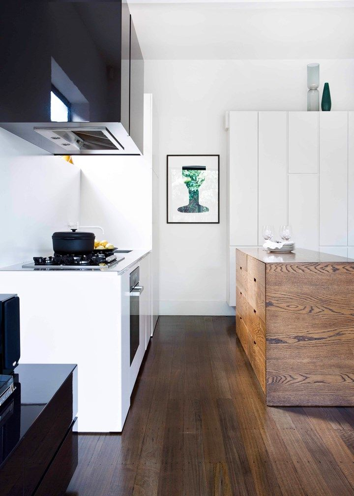 Good planning and great storage allow this busy kitchen, dining and living space to maintain a cool facade