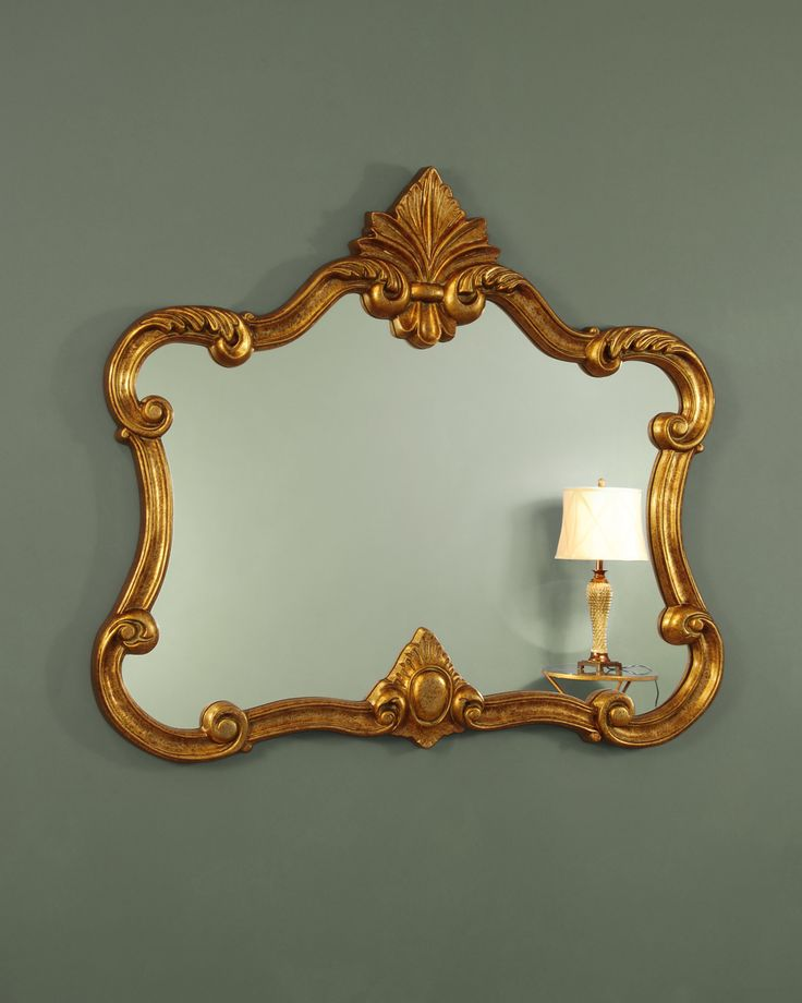 A striking landscape overmantle mirror with a wonderful sumptuous design. The frame sweeps inwards at the sides and outwards and the corners with expressive curved sections that are embellished with graceful scrolls and acanthus leaf flourishes. At the centre of the lower edge is an elegantly framed cabochon moulding and a large Fleur de Lys crest presides at the top of the mirror.