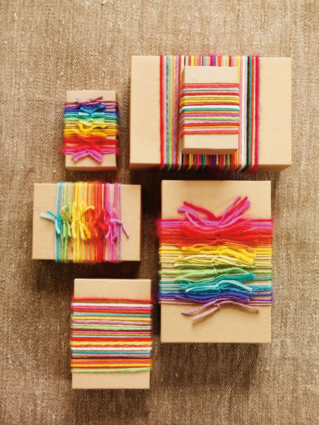 5 Handmade Gift-Packaging Ideas | Wrap bits of leftover yarn over kraft paper for a beautiful rainbow effect, from More Last-Minute Knitted Gifts by Joelle Hoverson