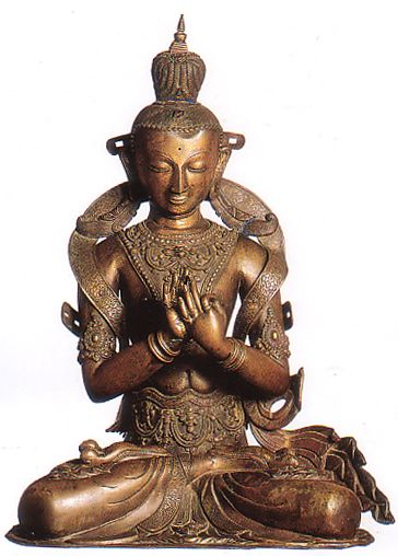 """In this contemplative image Maitreya, """"'The Benevolent"""" is turning the Wheel of the Iaw (dharmachakra mudra) in the Tushita Heaven. There as a Bodhisattva he teaches Buddhist doctrine to celestial beings until he descends to this world as the future mortal Buddha. Patan Museum"""