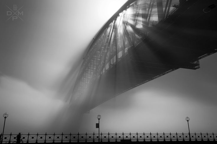 It was a spectacular fog filled morning today in Sydney. I was lucky enough to be out and about taking some pictures. After missing last years fog I vowed to capture it this time round, lucky for me I had the morning off work. Originally all that was on my mind was to shoot the rays shining through the bridge, although when looking back at the images there was something missing. So I took a few steps back and added a foreground, and this image is the end result.