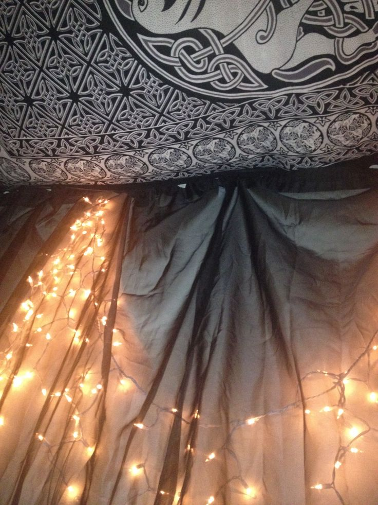 Hang sheer curtains over lights on the wall to create a