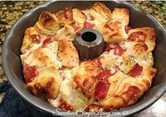 We know you'll enjoy sharing this Pull Apart Pizza Bread with the family! It's quick and easy and a meal in itself. Don't miss the Braided Spaghetti Bread too!