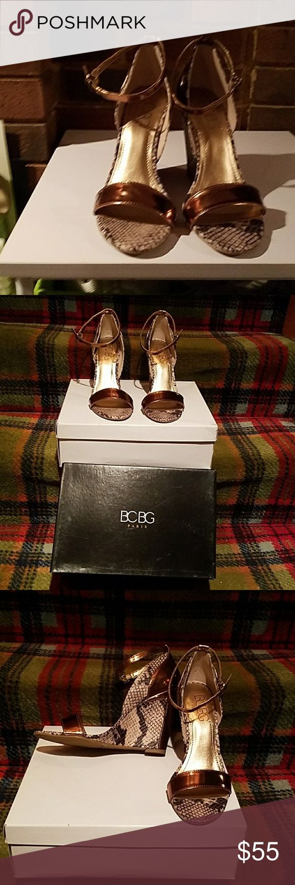 Shoes New, never worn 4 inch heel. Beautiful faux python snakeskin ankle wedge sandals with bronze patent leather strip across the toes, back of the heel and the ankle strap. BCBG Shoes Wedges